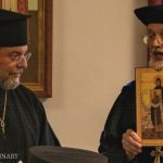 Fr. Alexander F.C. Webster, Dean of Holy Trinity Orthodoxy Seminary, presenting the icon of St. Job of Pochaev to Fr. Patrick Viscuso